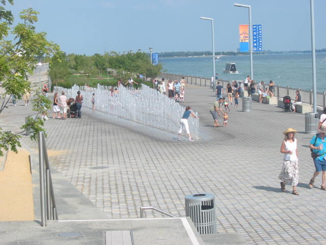 The Detroit River Walk spans along the Detroit River with activities and views of parks and the GM Renaissance Center.